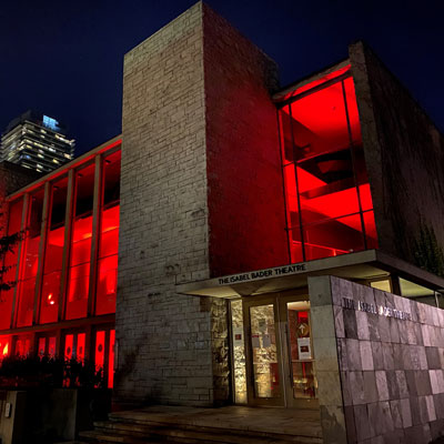 Isabel Bader Theatre lit in red to support Light Up Live